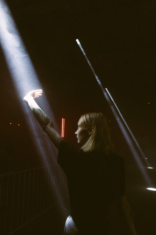 woman raising hand light