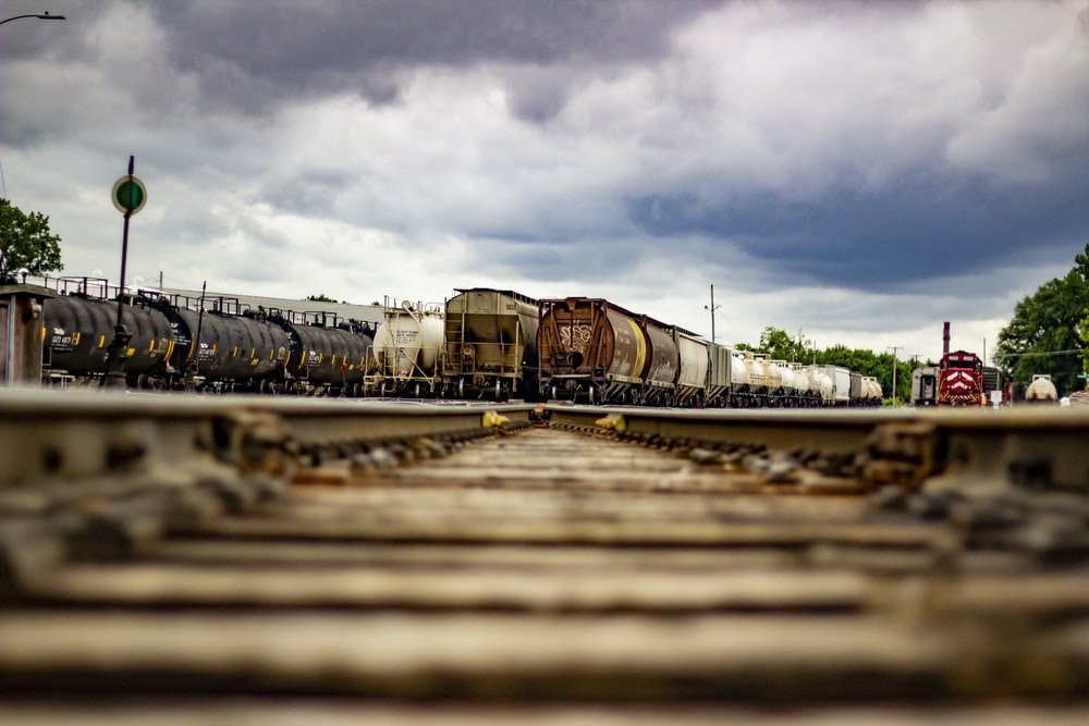 trains under cloudy sky