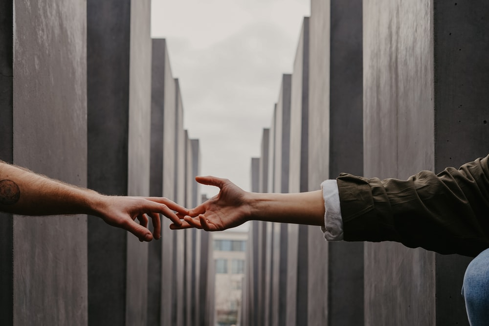 two people reaching hands