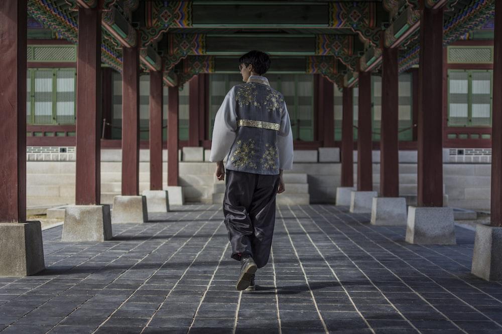 man walking under the building