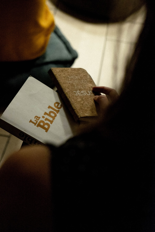 person holding La Bible