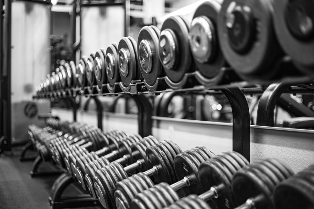 gray scale photo of dumbbells