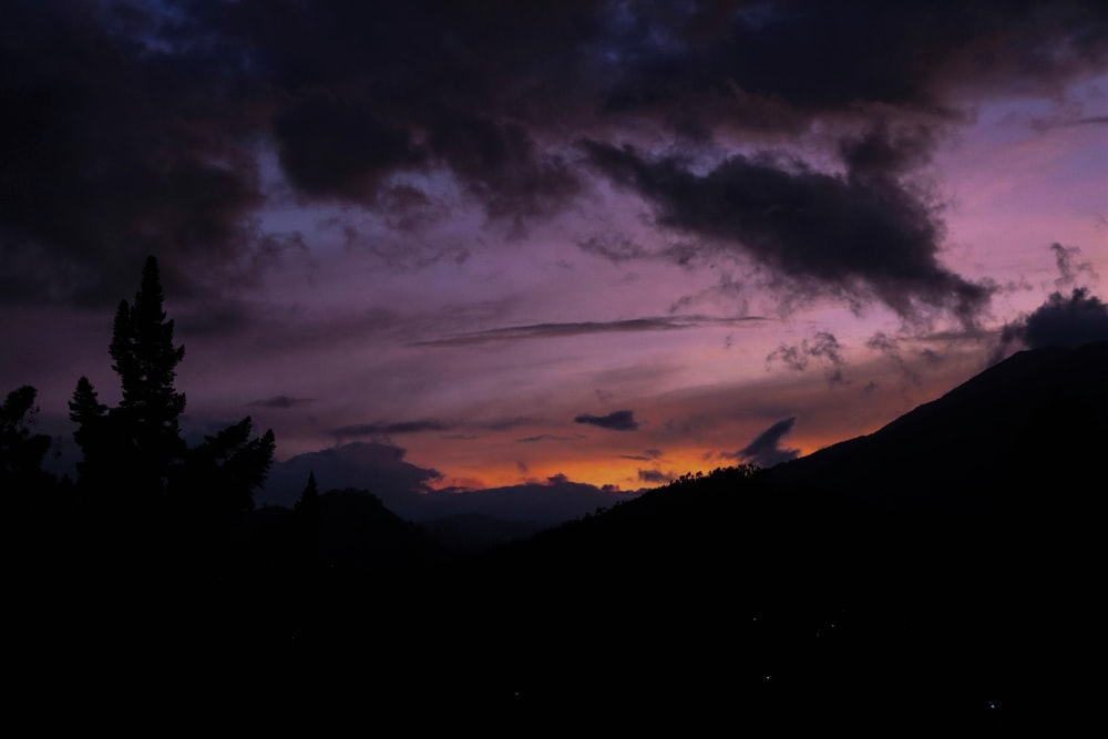 silhouette of mountain and trees