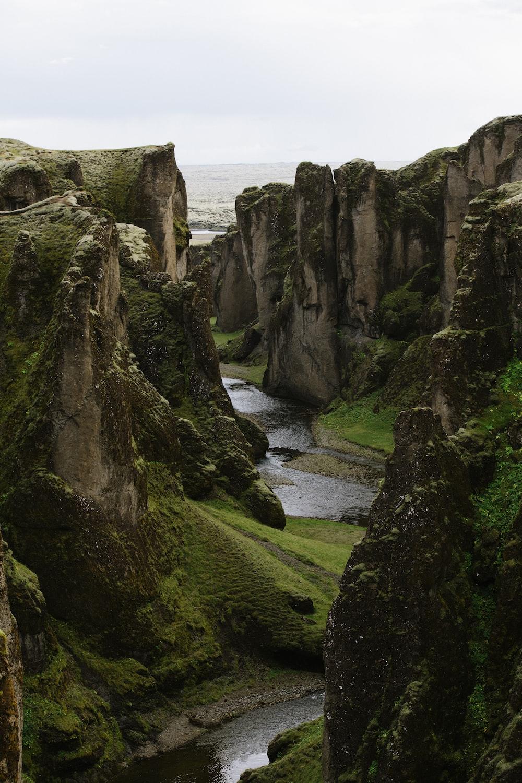 river in deep gorge between rock faced hills