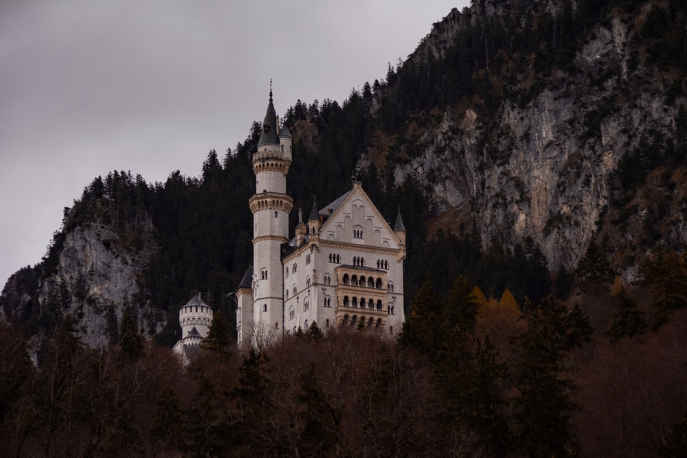 white painted castle in mountain top