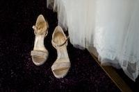 pair of women's silver open toe pumps