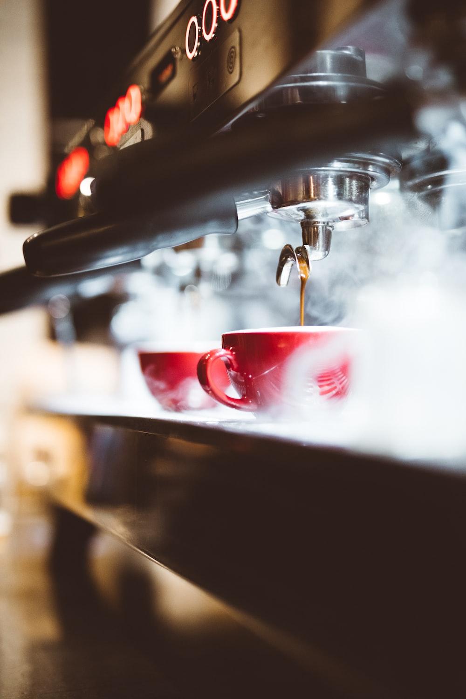 espresso poured on red mug