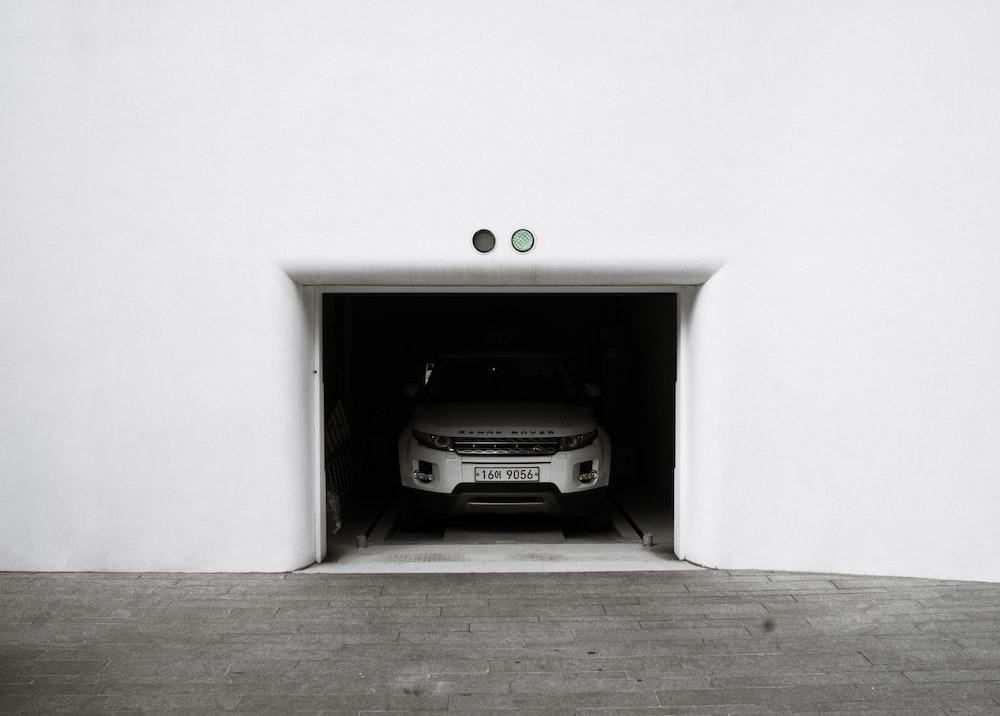 silver Land Rover Range Rover SUV parked inside garage
