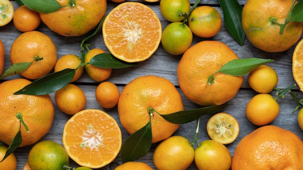 orange fruits on gray wooden surface
