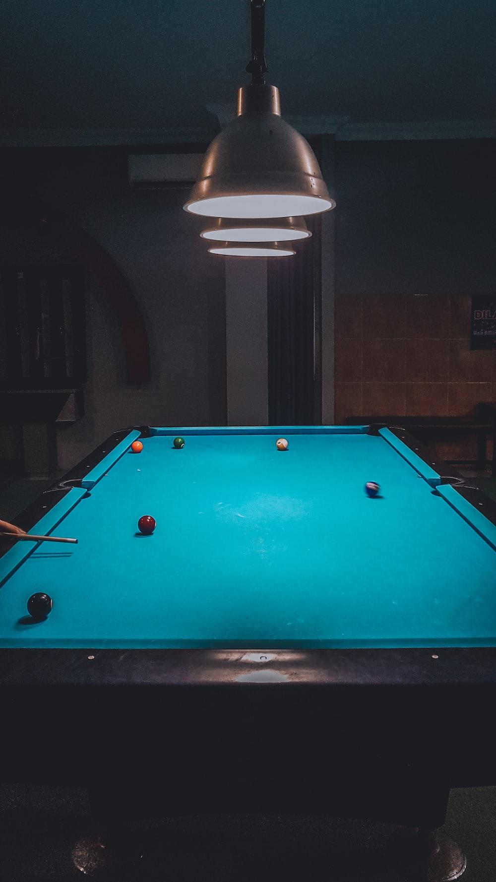 shallow focus photo of blue billiard table