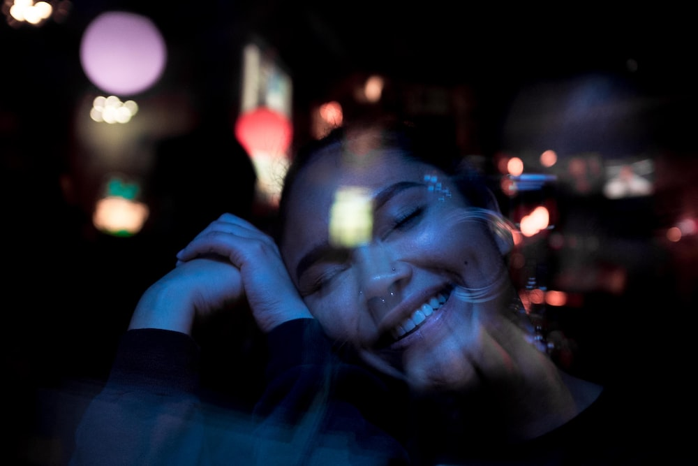 bokeh photography of woman's face
