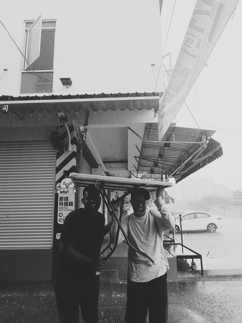 2 men carrying table