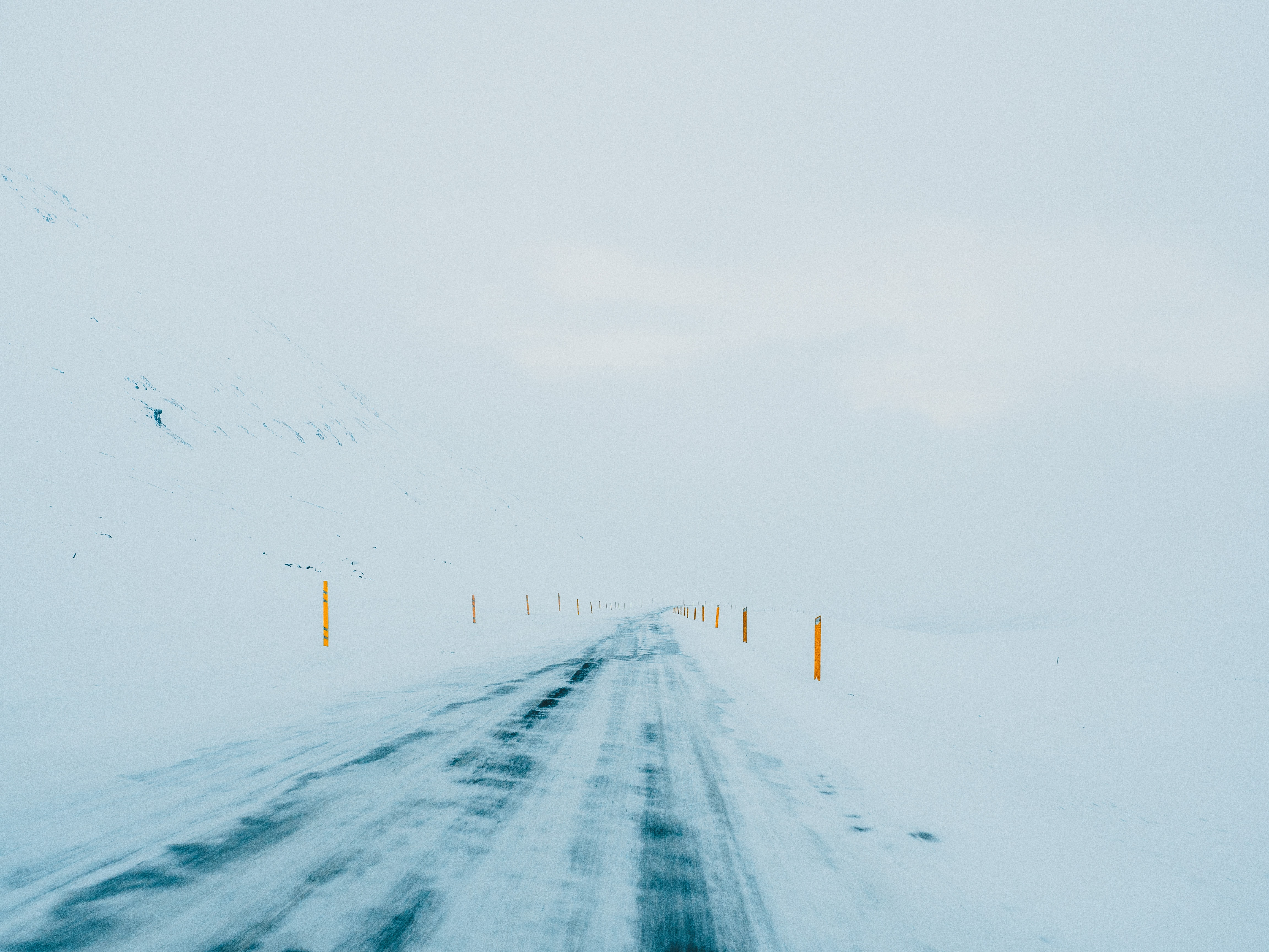 road coated by snow