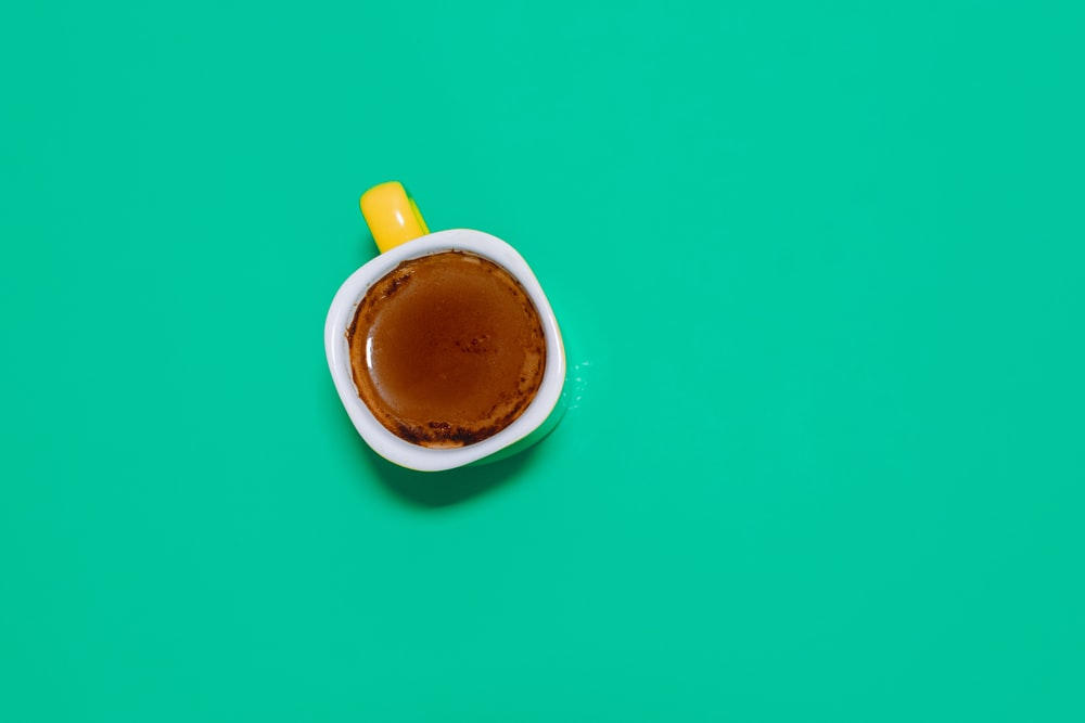 coffee in cup on green surface