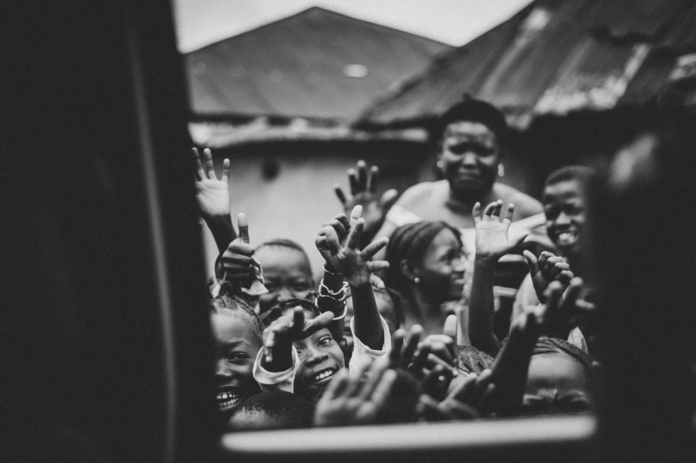 view of children outside vehicle
