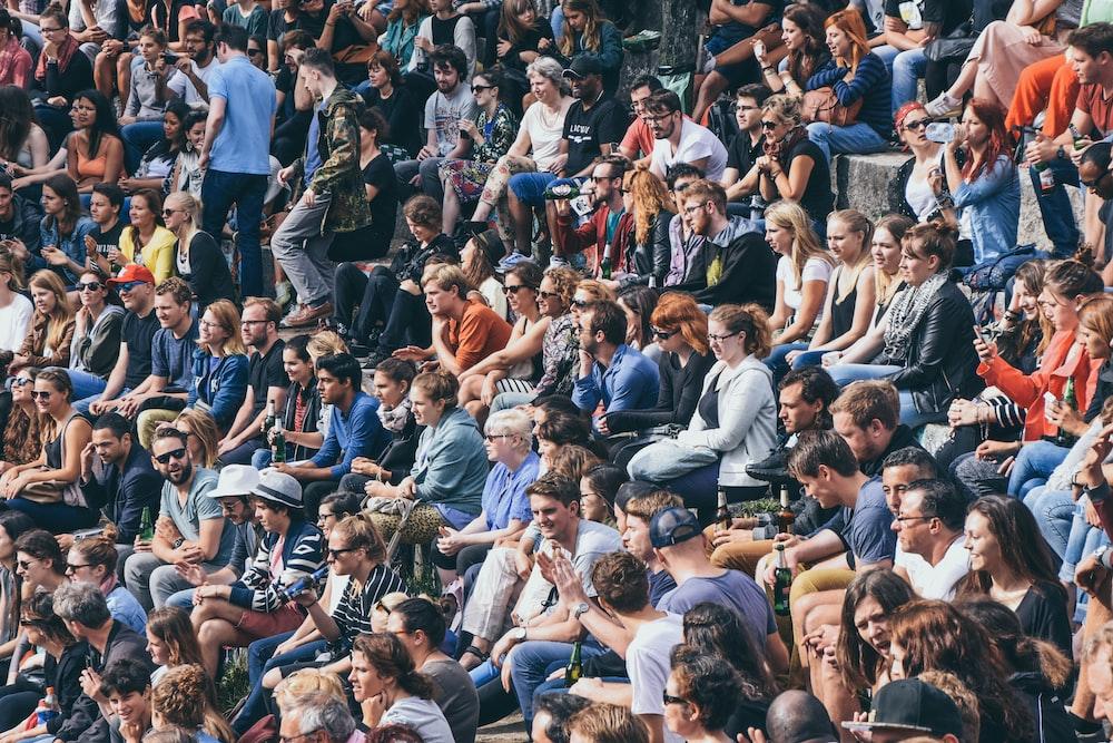 people sitting on stadium