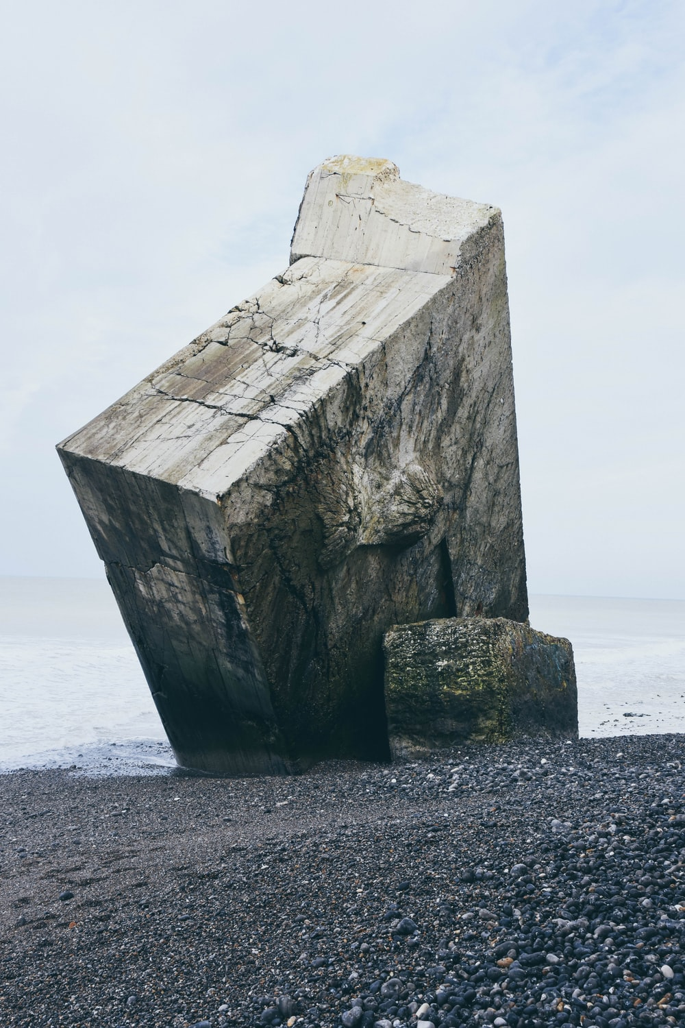 gray stone tablet on shore