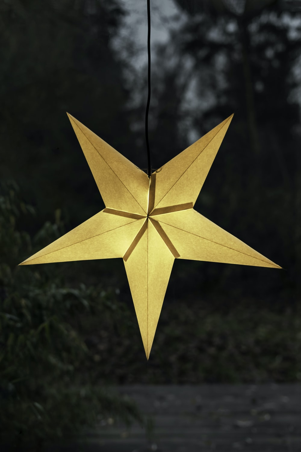 yellow star hanging decor with light