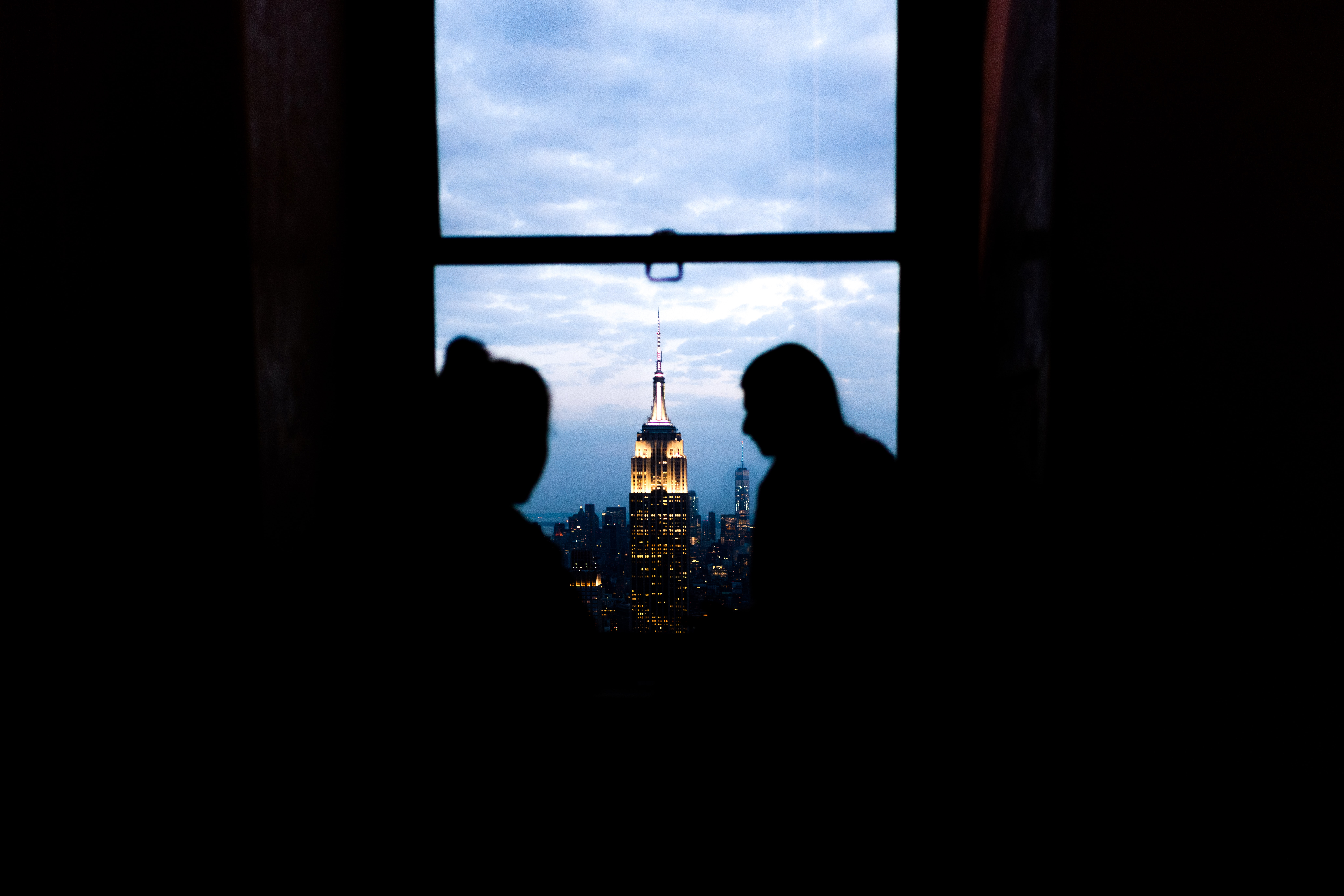 picture of couple in window