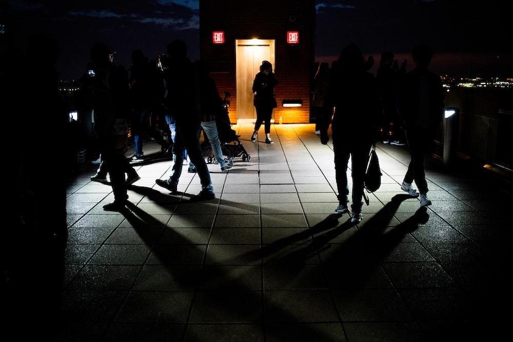 people standing on gray floor tiels