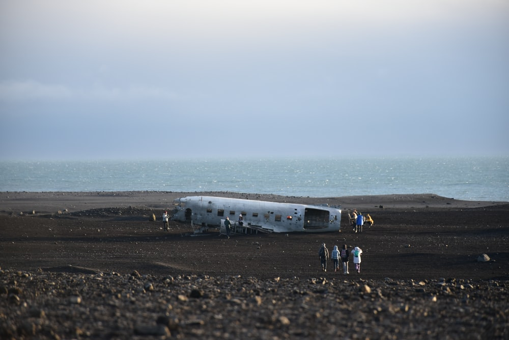 wrecked plane on black sand