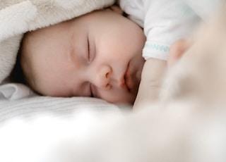 selective focus photography of sleeping baby
