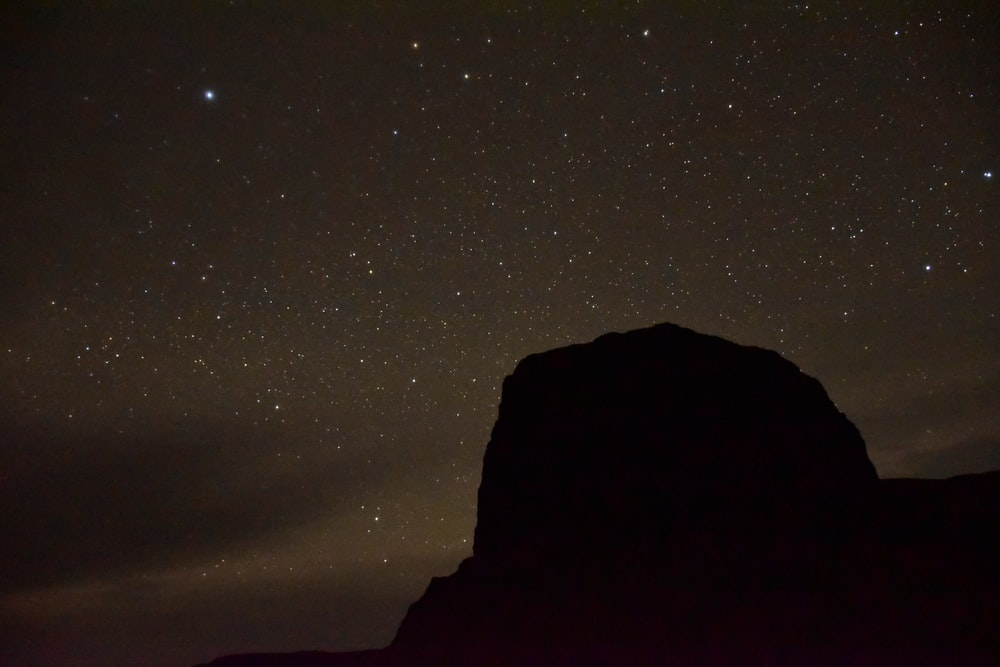 rock formation silhouette during nighttime