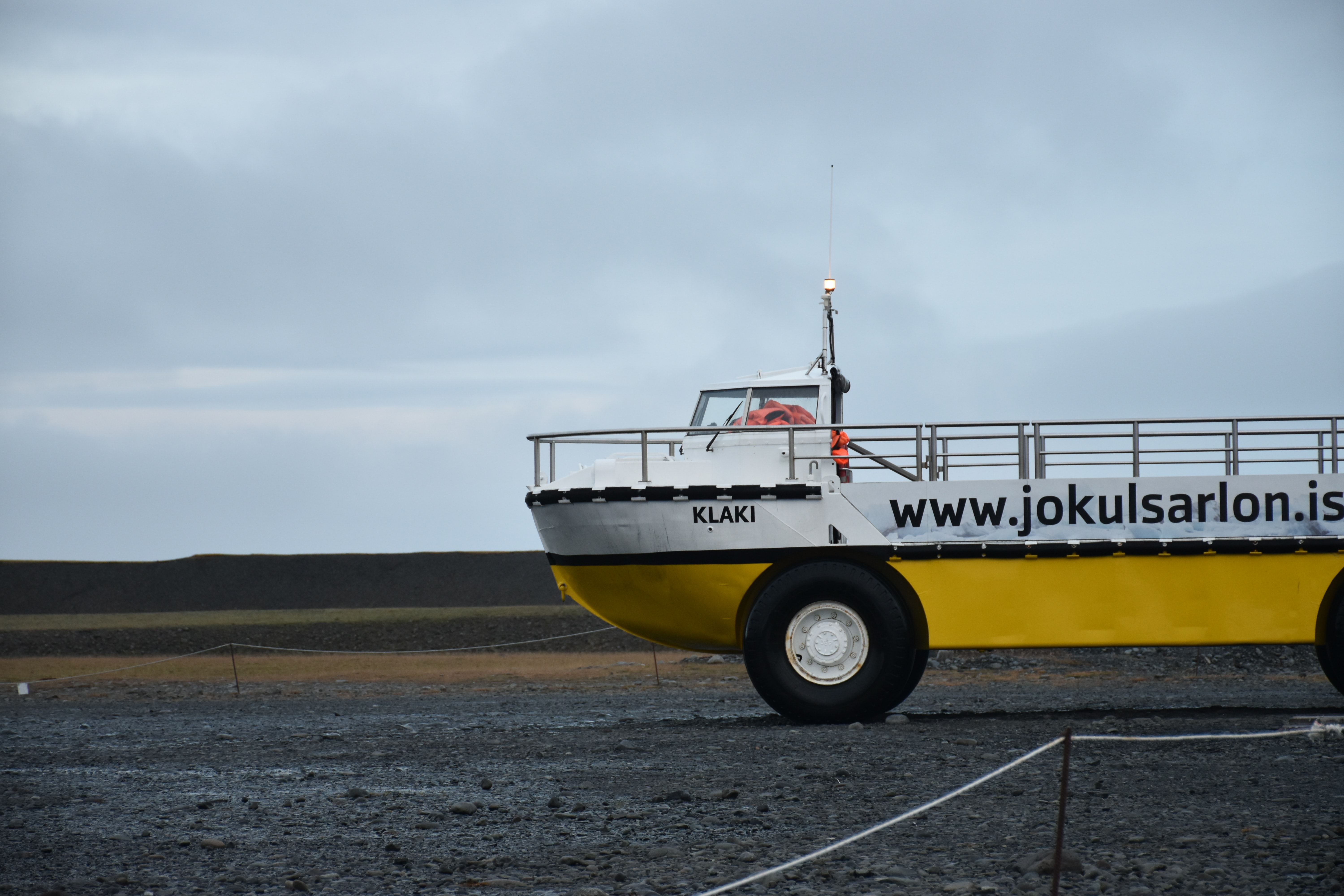 white and yellow ship vehicle at the field during day