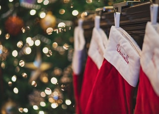four red-and-white Christmas stockings