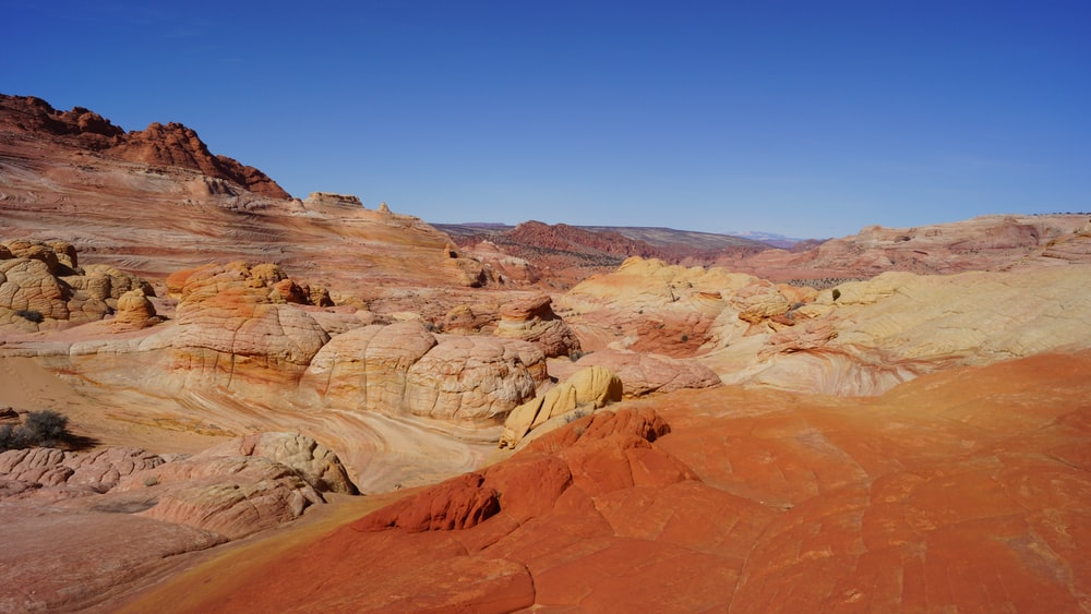 brown rock formations under blue sky
