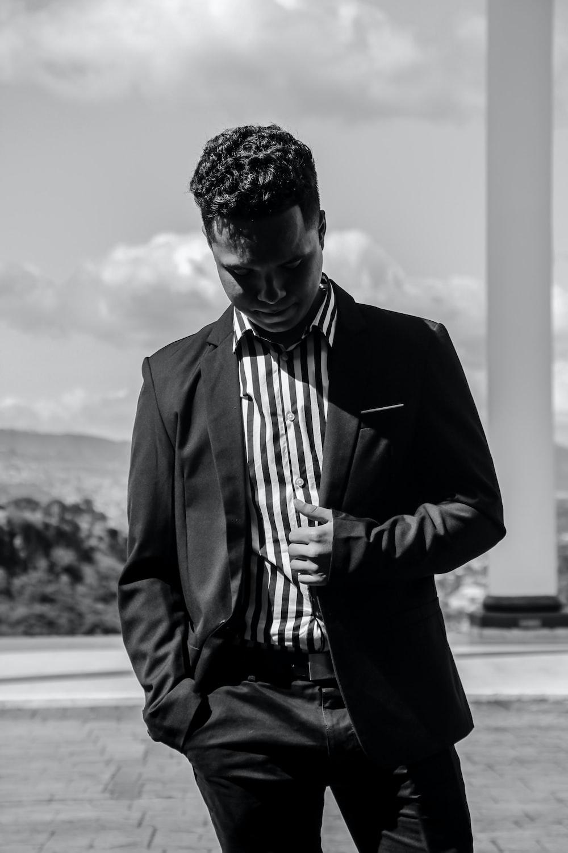 greyscale photo of man wearing tuxedo