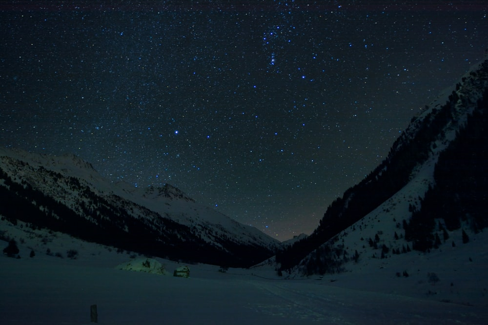 snow covered mountain under the starry night