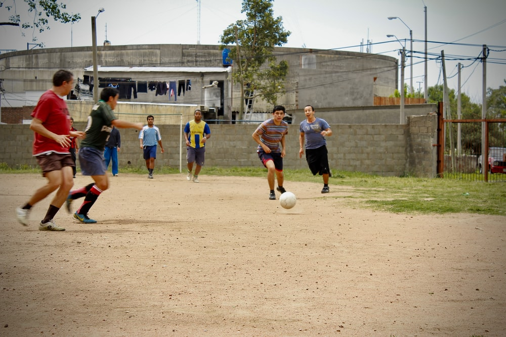 group of men playing soccer