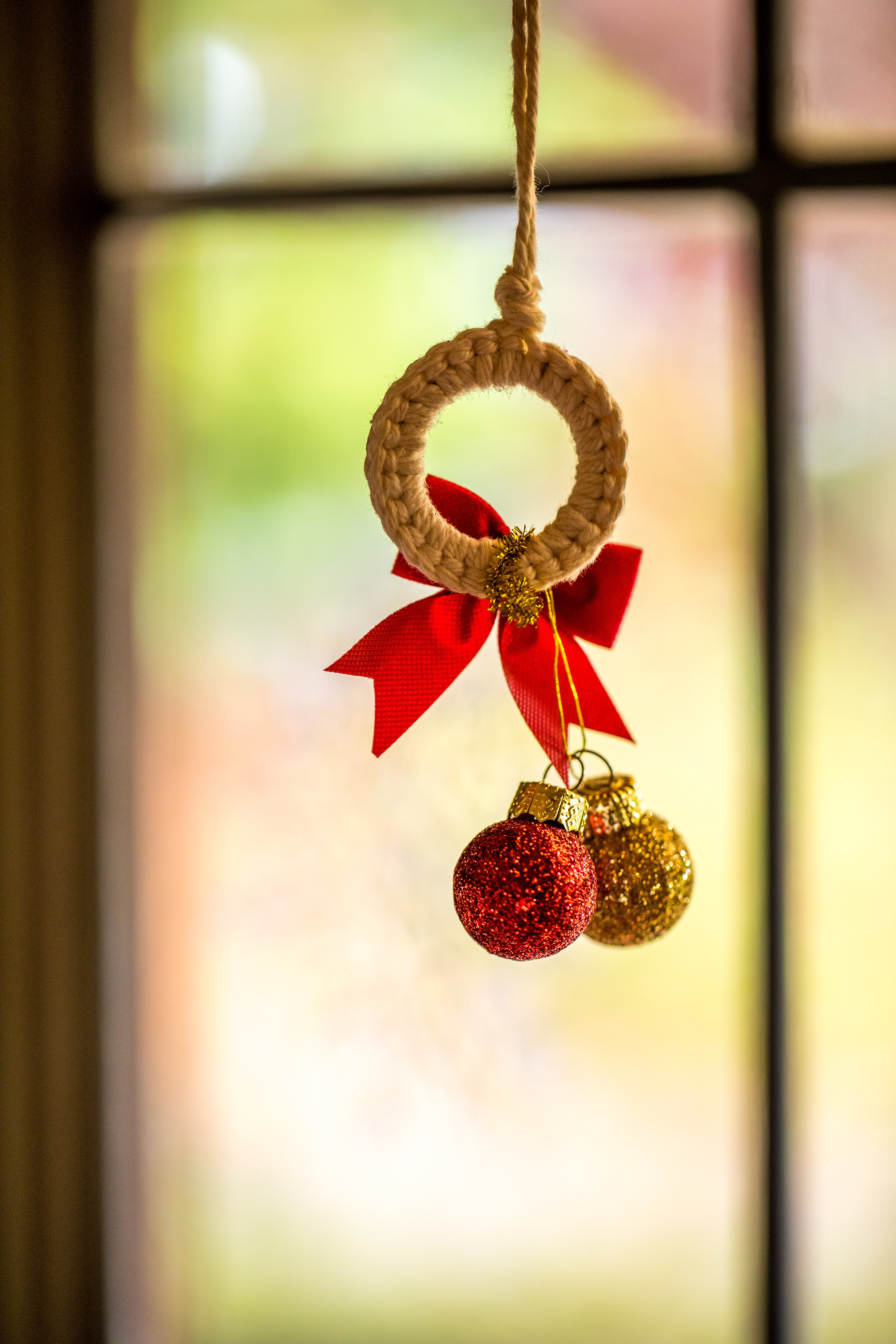 two red and yellow christmas baubles