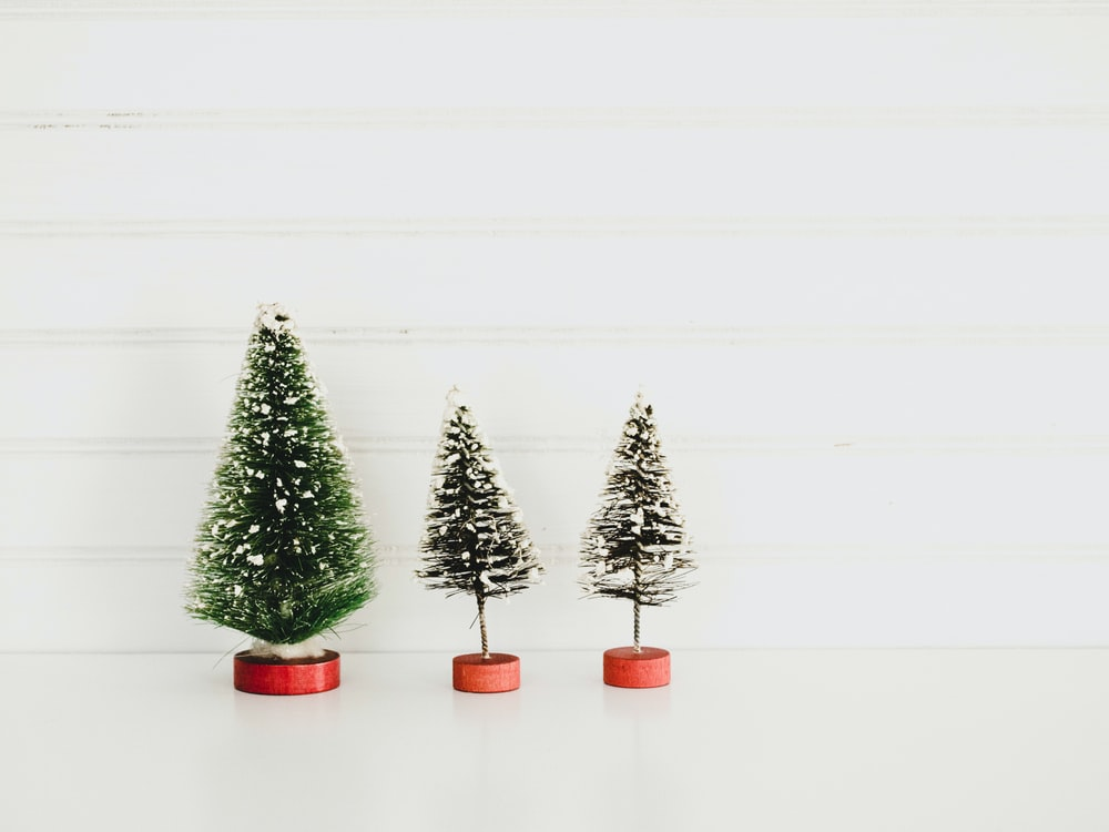 three green christmas tree decors