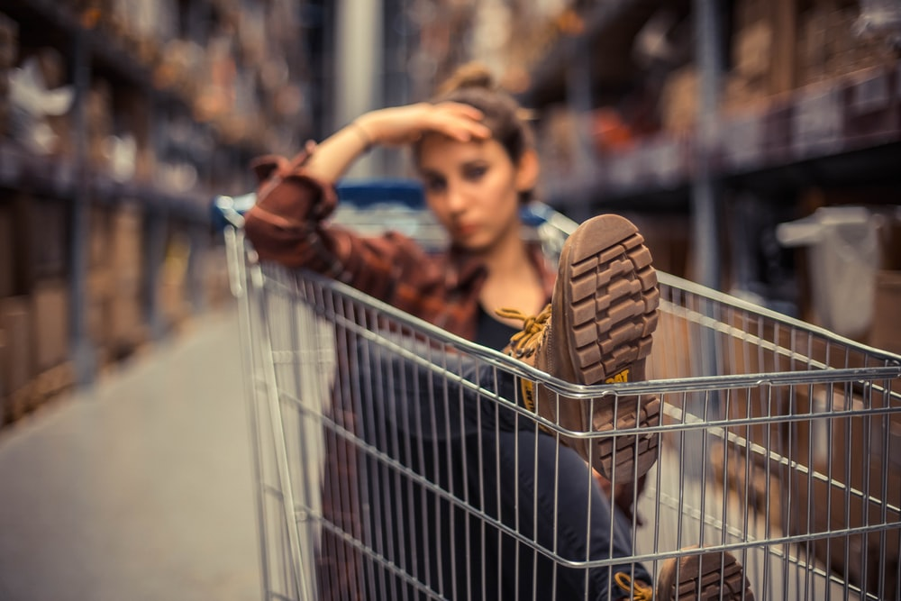 selective focus photography of woman sitting inside push cart
