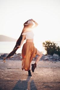 woman in orange skirt
