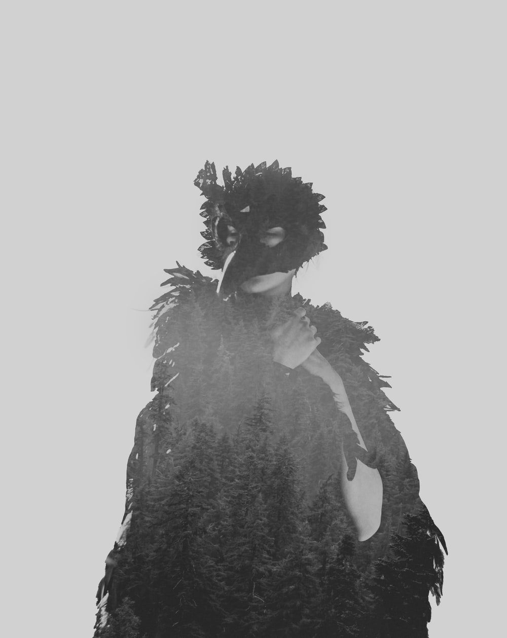 woman wearing black crow adult costume