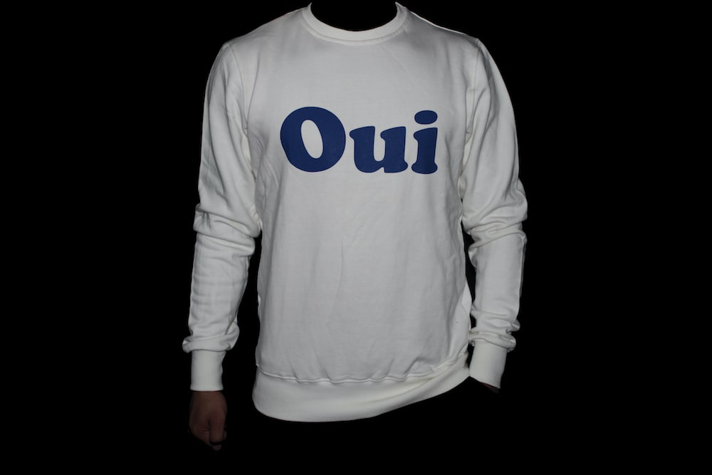 white and blue long-sleeved shirt