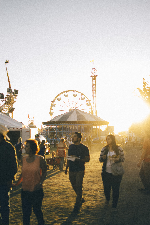group of people walking on amusement park
