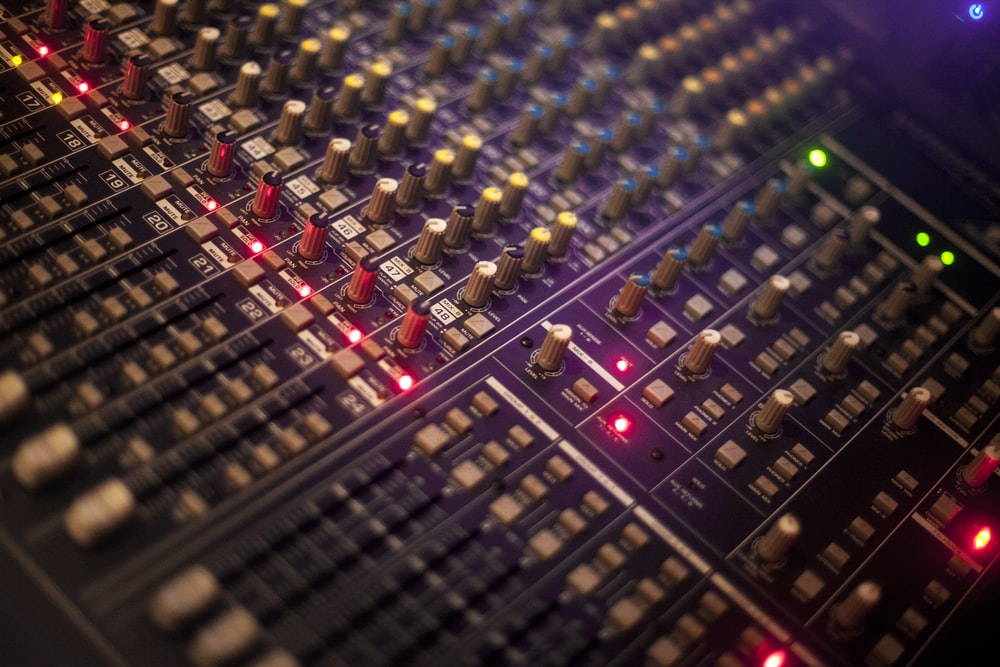 selective focus photography of audio mixer