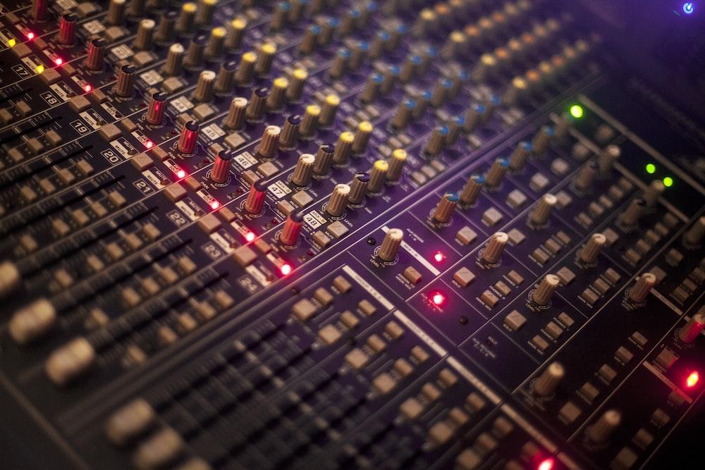 selective focus photography of audio mixer