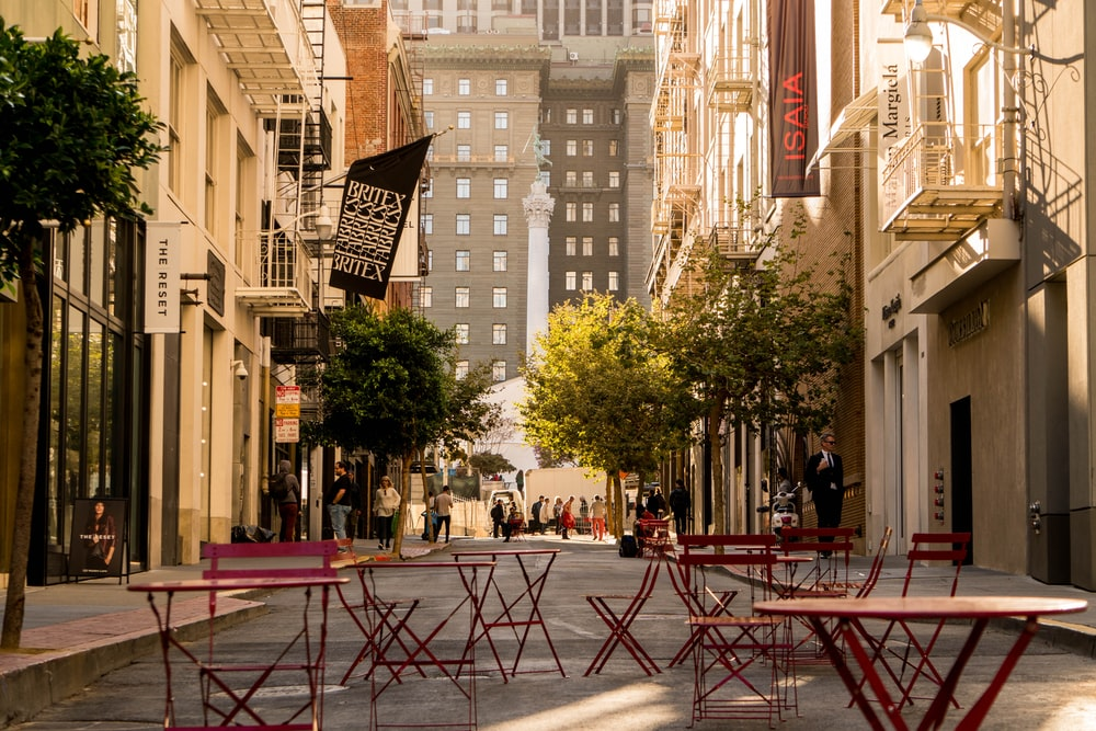 red wooden folding tables and chairs on street