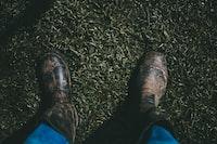 person wearing black rain boots