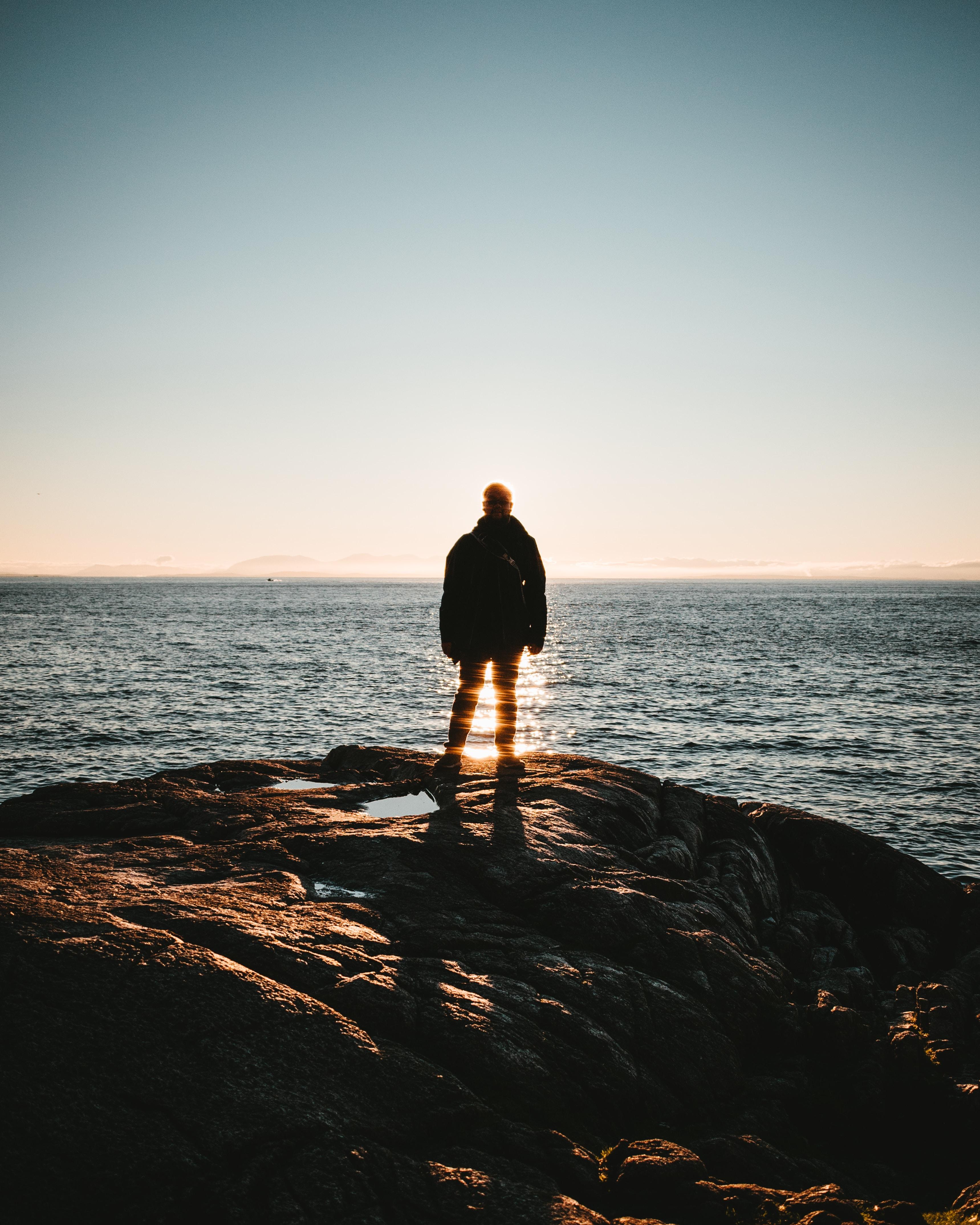 man standing on seacliff