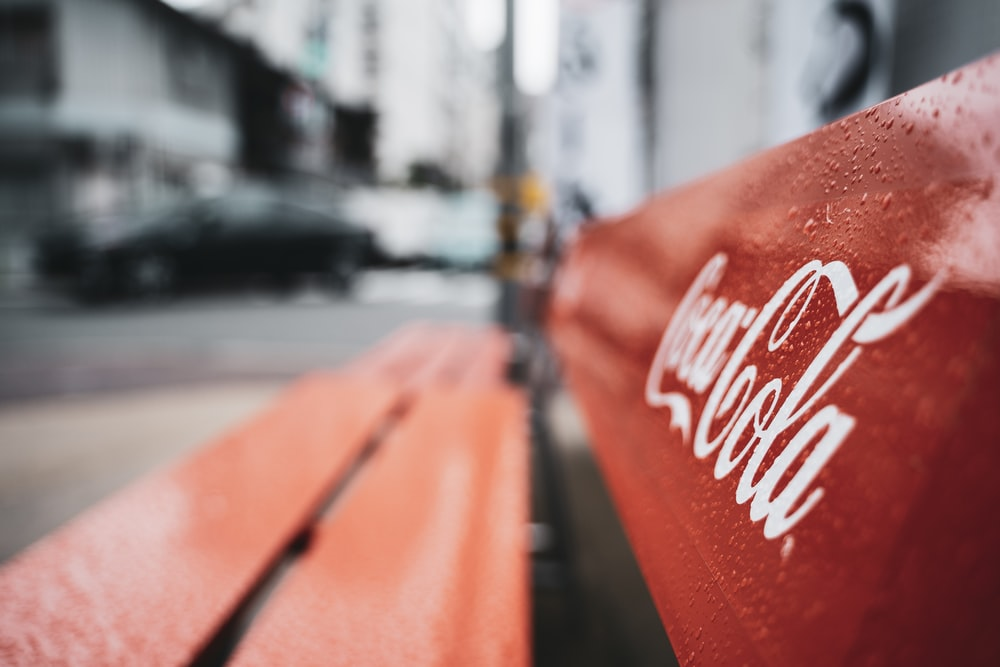 shallow focus photography of red wooden bench