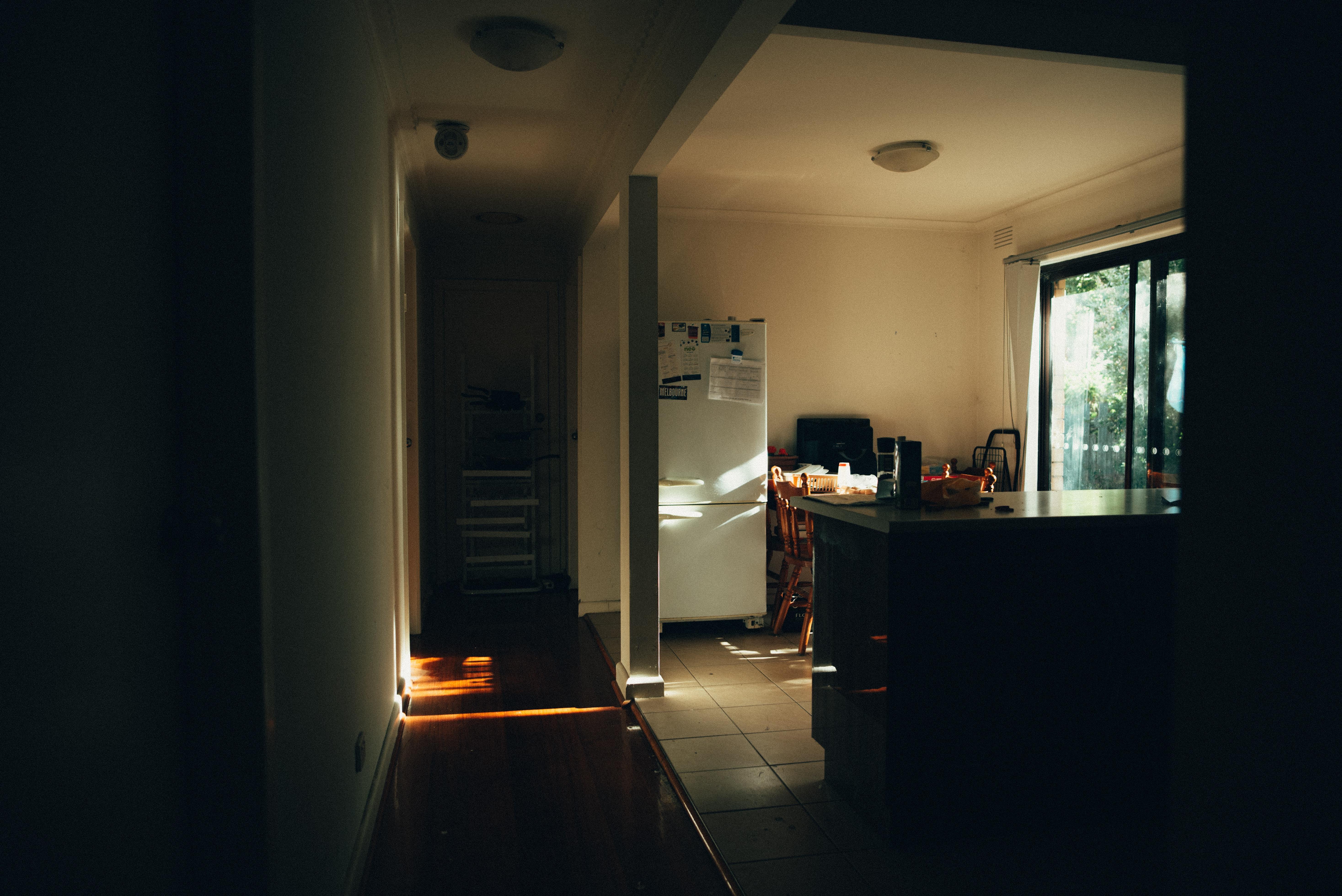 white bottom-mount refrigerator near window inside house