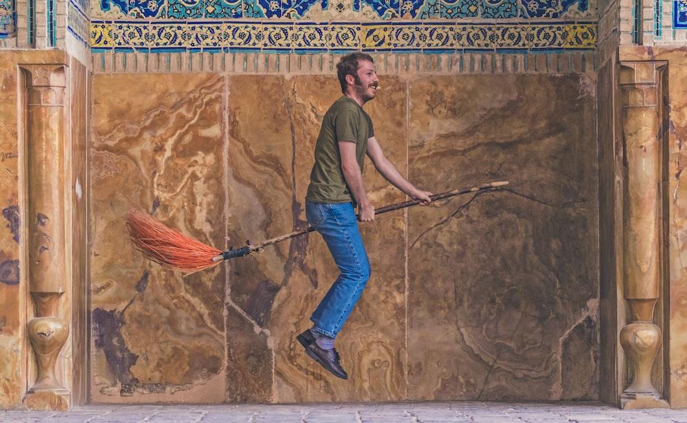 man riding on levitation broom painting