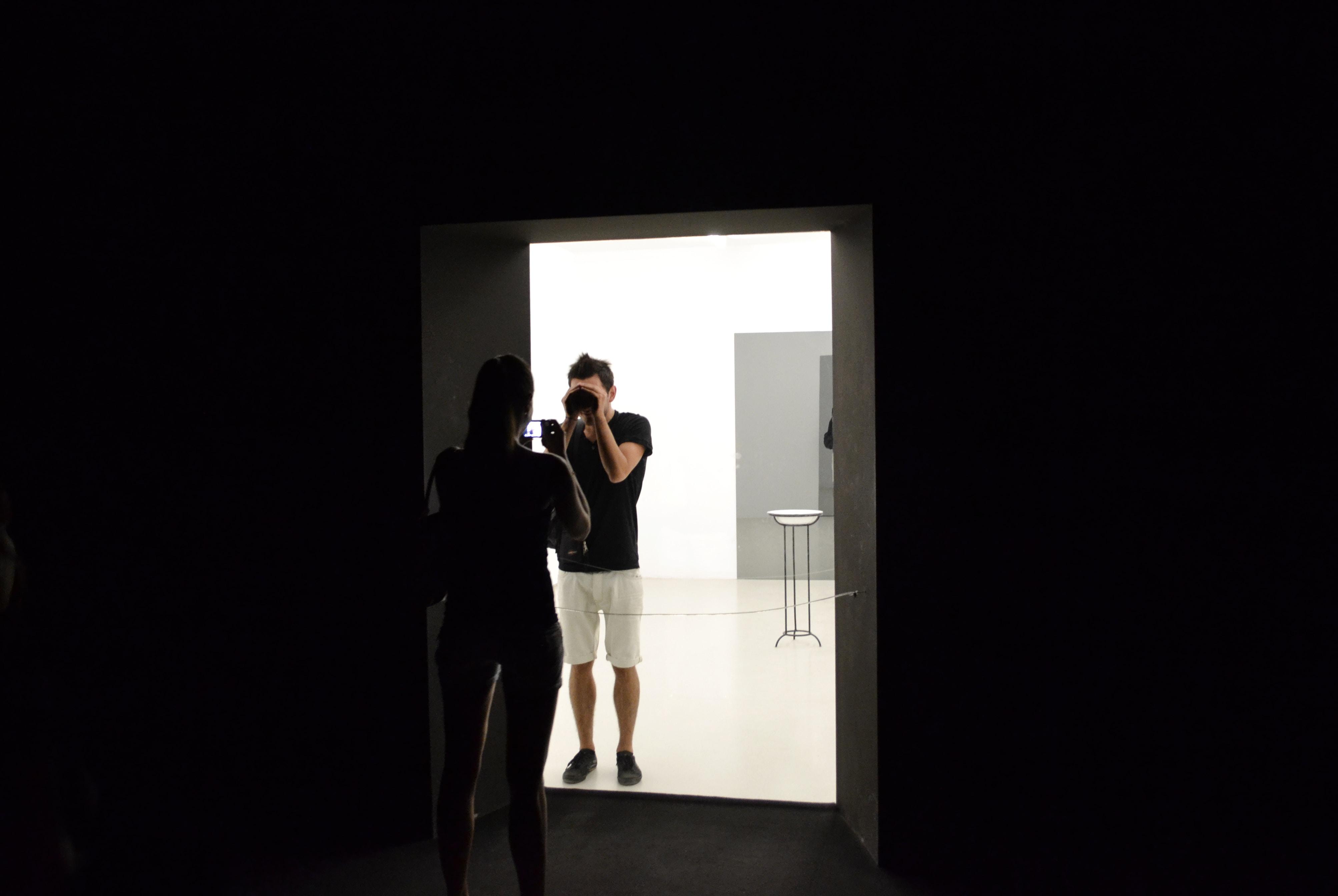man in black shirt holding camera