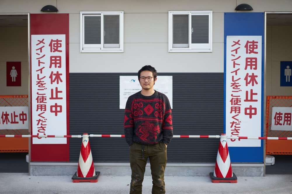 man wearing black and red crew-neck sweater